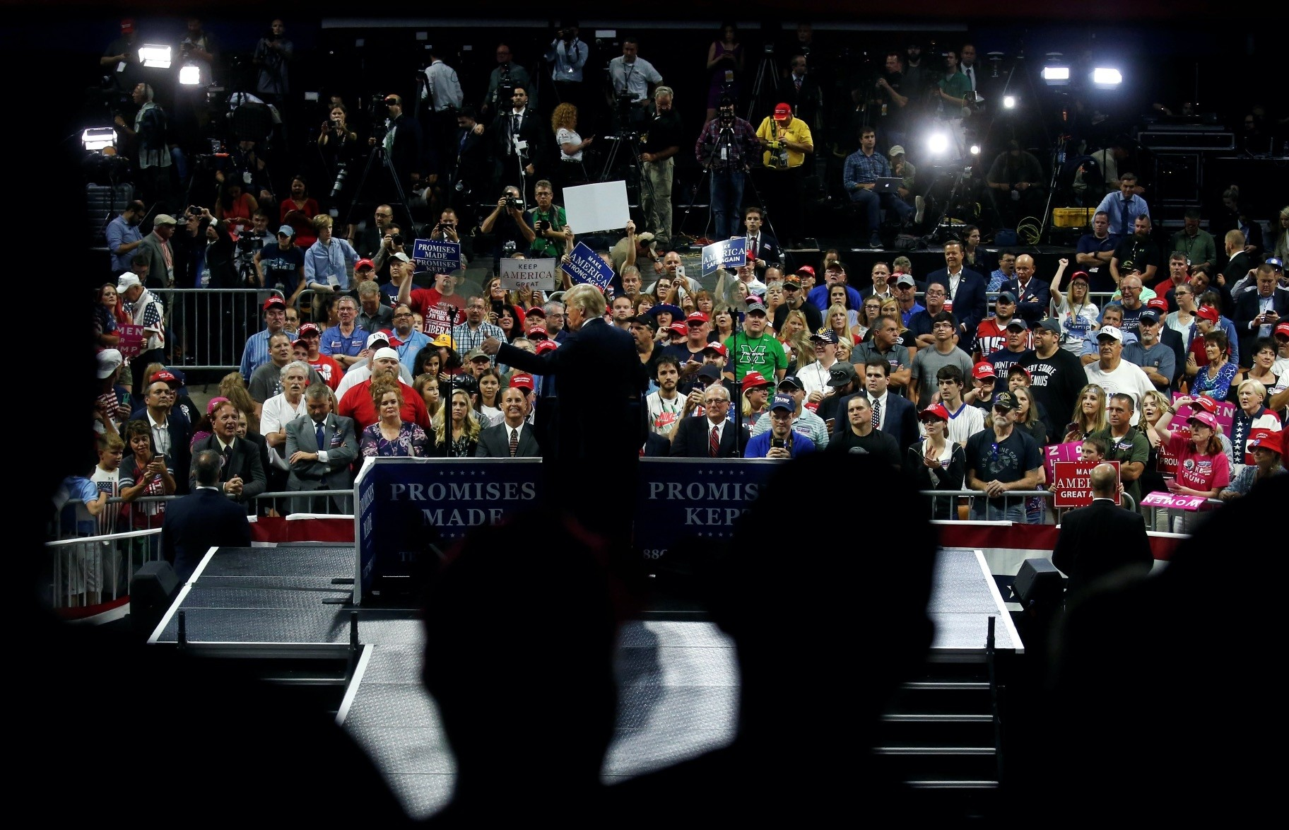 U.S. President Donald Trump speaks at a ,Make America Great Again, rally at the Civic Center in Charleston, West Virginia, Aug. 21.