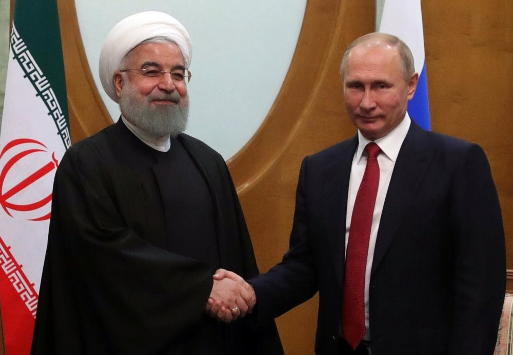 Iranian President Hassan Rouhani (L) shakes hands with Russian President Vladimir Putin (R) during a meeting in the Black sea resort city of Sochi, Russia, Nov. 22, 2017