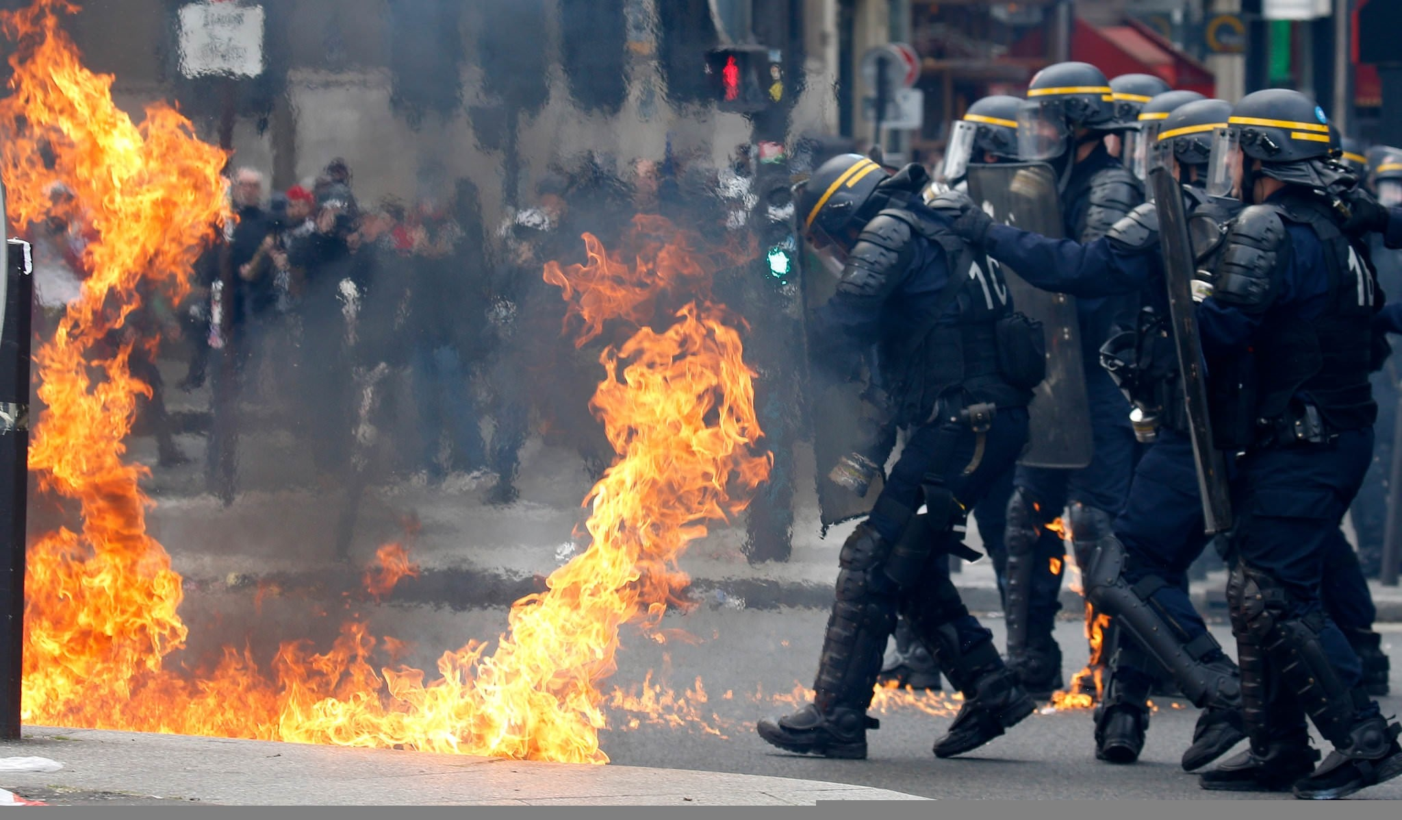 rench CRS riot police protect themselves from flames during clashes. (REUTERS Photo)