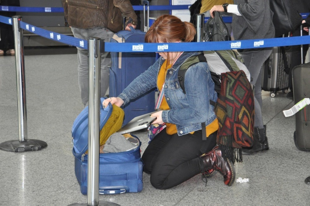 A passenger in Istanbul's Atatu00fcrk Airport puts her laptop in her luggage as she travels to the U.S.