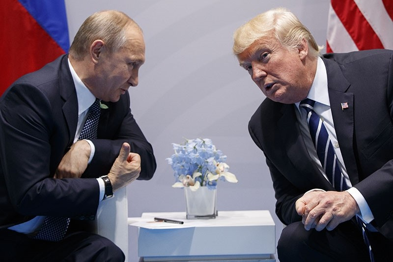 In this file photo taken on Friday, July 7, 2017, U.S. President Donald Trump meets with Russian President Vladimir Putin at the G-20 Summit in Hamburg, Germany. (AP Photo)