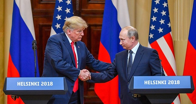 US President Donald Trump (L) and Russia's President Vladimir Putin shake hands before attending a joint press conference after a meeting at the Presidential Palace in Helsinki, on July 16, 2018. (AFP Photo)