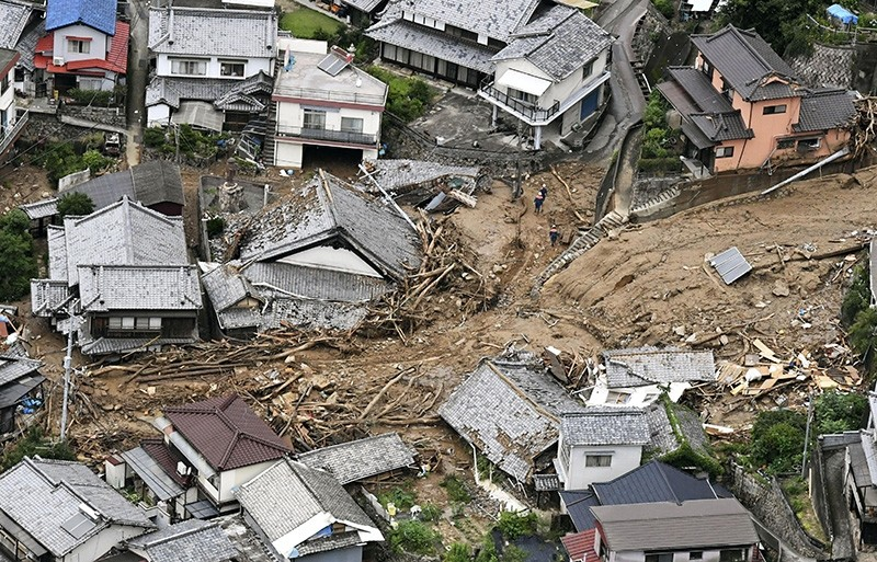 Houses are damaged by mudslide following heavy rains in Kure city, Hiroshima prefecture, southwestern Japan, Saturday, July 7, 2018. (AP Photo)