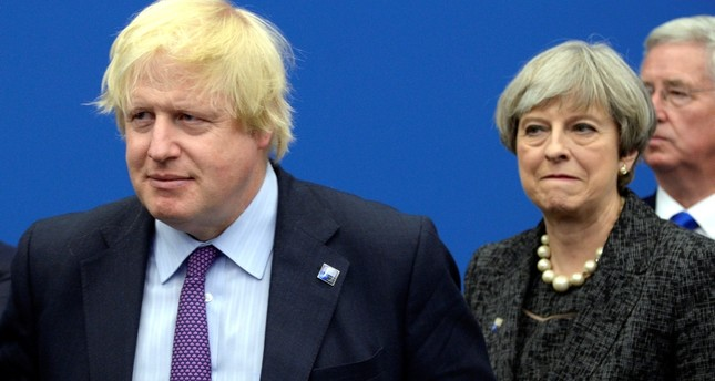 In this, May 25, 2017 file photo British Foreign Secretary Boris Johnson, left, and Britain's PM Theresa May arrive for a meeting during the NATO summit of heads of state and government in Brussels. (AP Photo)