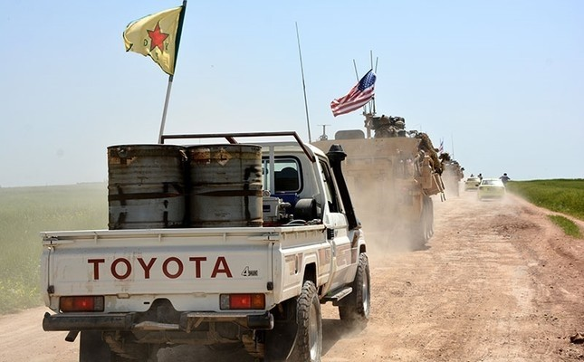 A convoy of U.S. army troops and YPG terrorists patrol close to the al-Ghanamya village, near the Syrian-Turkish border, Syria, April 29.
