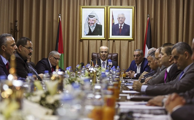 Palestinian Prime Minister Rami Hamdallah, center, chairs a reconciliation government cabinet meeting in Gaza City Tuesday, Oct. 3, 2017. (AP Photo)