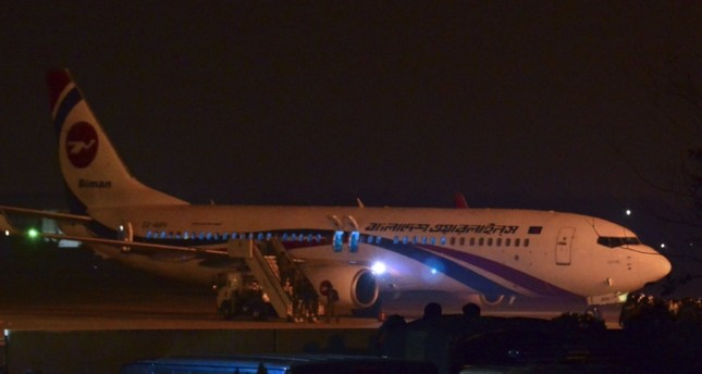 The hijacked Dubai-bound Bangladesh Biman plane is seen at the tarmac after an emergency landing at the Shah Amanat International Airport in Chittagong on February 24, 2019. (AFP Photo)