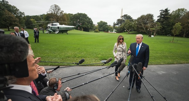 Trump answers reporter's questions about his decision to withdraw presidential certification of the Iran nuclear deal and about his moves to dismantle the Obamacare