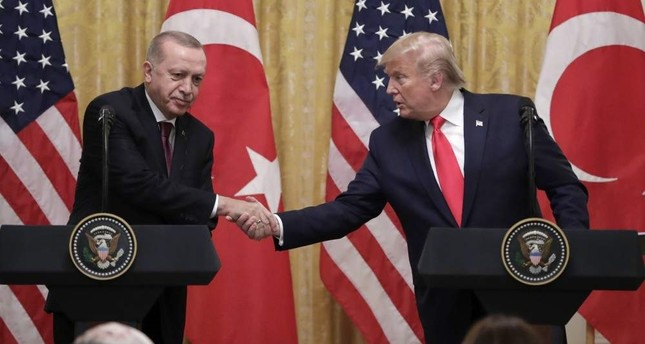 President Recep Tayyip Erdo?an and U.S. President Donald Trump R shake hands during a news conference in the East Room of the White House, Nov. 13, 2019. AP Photo