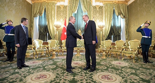 Russian President Vladimir Putin L shakes hands with Turkish President Recep Tayyip Erdoğan R prior to the sixth meeting of the High-Level Russian-Turkish Cooperation Council in the Kremlin in Moscow, Russia, March 10, 2017. EPA Photo