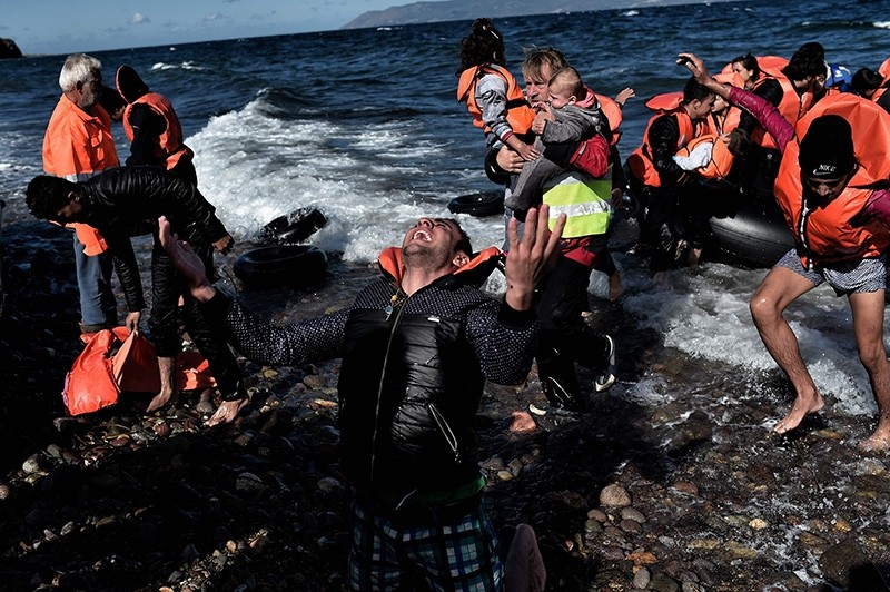 This file photo taken on October 29, 2015 shows a man reacting as he arrives, with other refugees and migrants, on the Greek island of Lesbos after crossing the Aegean sea from Turkey. (AFP Photo)