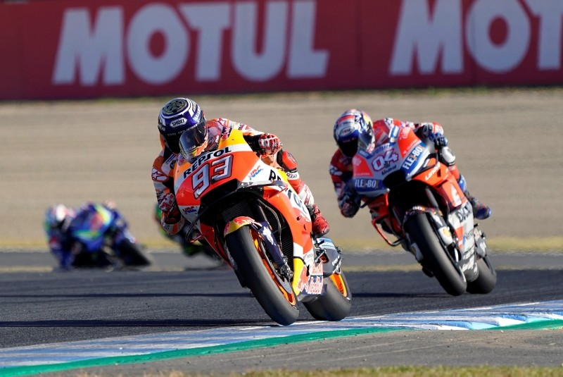 Spain's rider Marc Marquez steers his Honda tailed by Italy's Andrea Dovizioso of the Ducati duringthe MotoGP Japanese Motorcycle Grand Prix. (AP Photo)