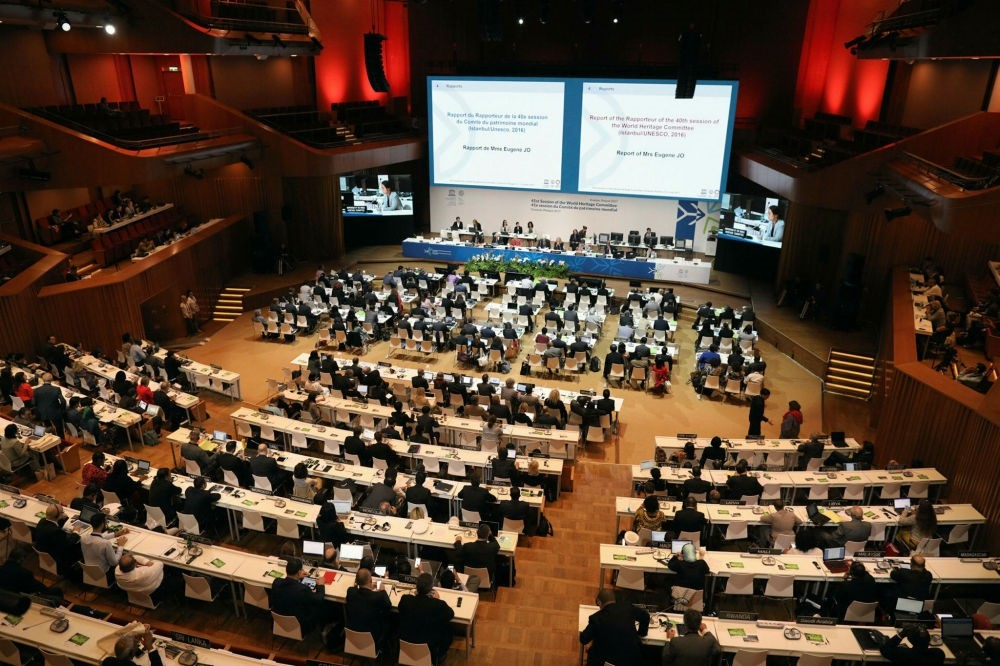 Attendees sit during the opening of the 41st session of the United Nations Educational, Scientific and Cultural Organization (UNESCO) World Heritage Committee at the ICE Krakow Congress Centre in Krakow, Poland, July 3.