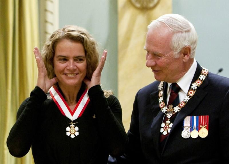 Canadian astronaut Julie Payette (L), smiles after being awarded the rank of Officer in the Order of Canada by Governor General David Johnston at Rideau Hall in Ottawa September 16, 2011. (Reuters Photo)