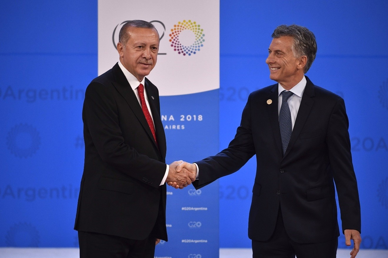 President Recep Tayyip Erdou011fan (L) is welcomed by Argentina's President Mauricio Macri at Costa Salguero in Buenos Aires during the G20 Leaders' Summit, on Friday.