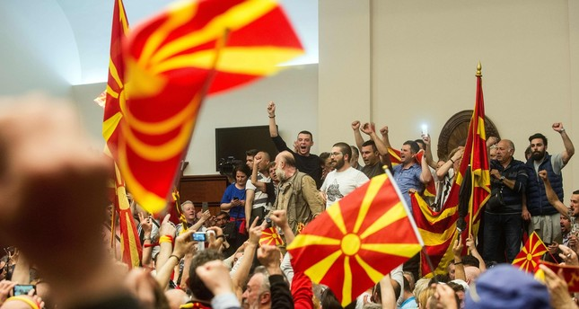Protesters demonstrate inside Macedonia's parliament to protest against what they said was an unfair vote to elect a parliamentary speaker. (AFP Photo)