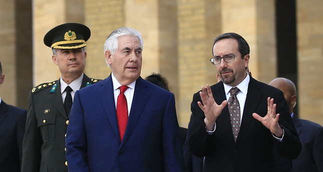 U.S. Ambassador John Bass (R) talks to U.S. Secretary of State Rex Tillerson (L) during a visit in Ankara, March 30.