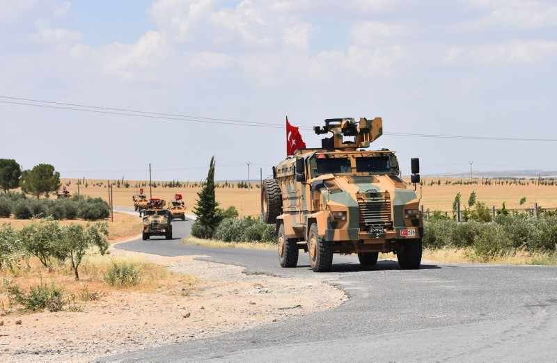 A handout picture released by the Turkish Armed Forces shows Turkish soldiers accompanied by armored vehicles patrolling near the city of Manbij in northern Syria, on June 18, 2018. (AFP Photo)