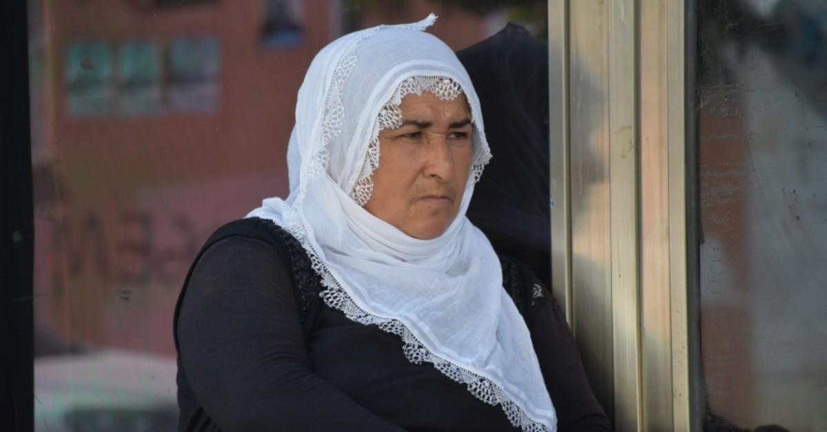 Fevziye u00c7etinkaya sits in front of the HDP headquarters in Diyarbaku0131r province (AA Photo)