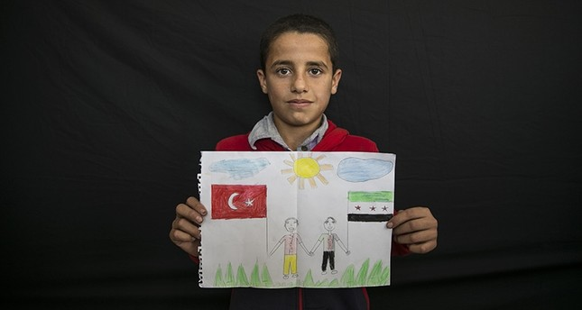 12-year-old Syrian student Sami Abdullah expresses his love for Turkey in a drawing. (AA Photo)