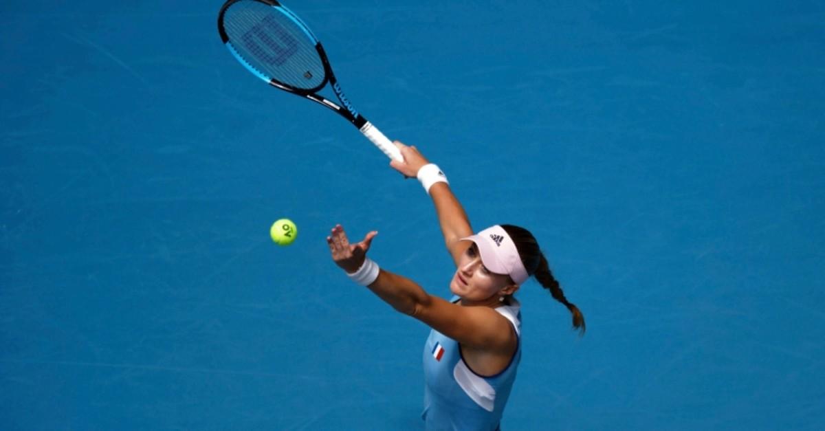 France's Kristina Mladenovic serves to Australia's Ash Barty during their Fed Cup tennis final in Perth, Australia, Sunday, Nov. 10, 2019. (AP Photo)