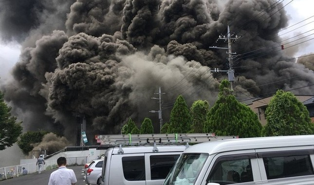 Smoke rising from a construction site on fire, in the western Tokyo city of Tama on July 26, 2018. IHA Photo