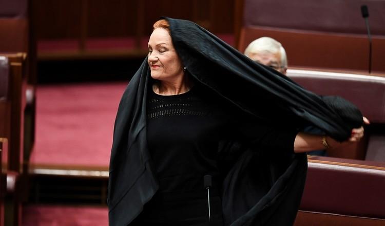 Australian anti-immigration politician Pauline Hanson caused a furore when she entered the Senate wearing a full burka. (AFP Photo)