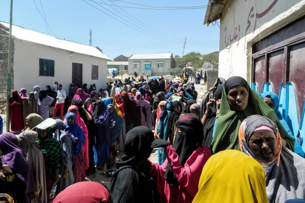 People wait in a line to cast their votes in the presidential election at a polling station in Hargeisa, Somaliland, Nov. 13.