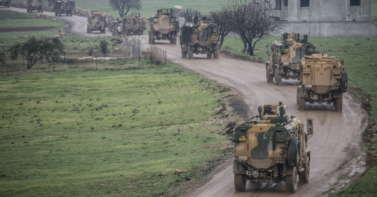 Turkish military vehicles being deployed to one of the observation points in Idlib