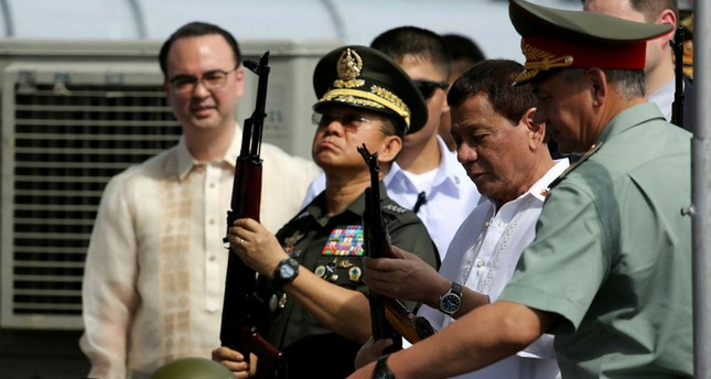 Philippine President Rodrigo Duterte inspects Kalashnikov rifles with Russian Defense Minister Sergei Shoigu, Oct. 25.