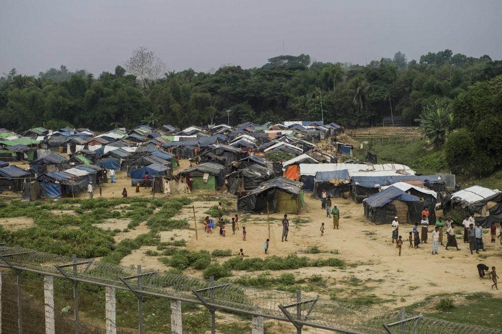 Rohingya refugees gather near their shelters in ,no man's land, behind Myanmar's border lined with barb wire fences, Rakhine state, April 25.