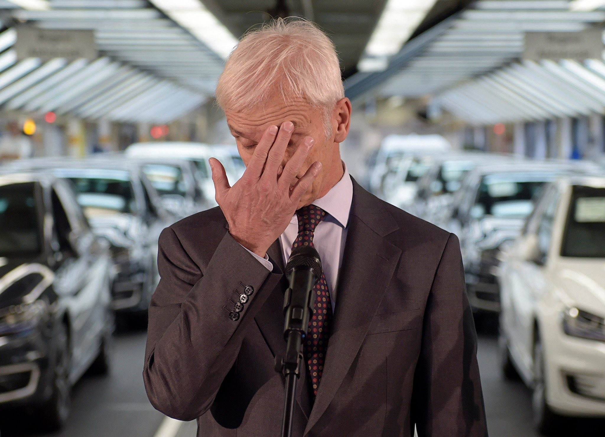 Matthias Mueller, CEO of German car maker Volkswagen, gestures while addressing journalists after visiting an assembly line of the VW plant in Wolfsburg, central Germany, on Oct. 21, 2015.