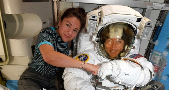 In this image released Friday, Oct. 4, 2019, by NASA, astronauts Christina Koch, right, and, Jessica Meir pose on the International Space Station AP Photo
