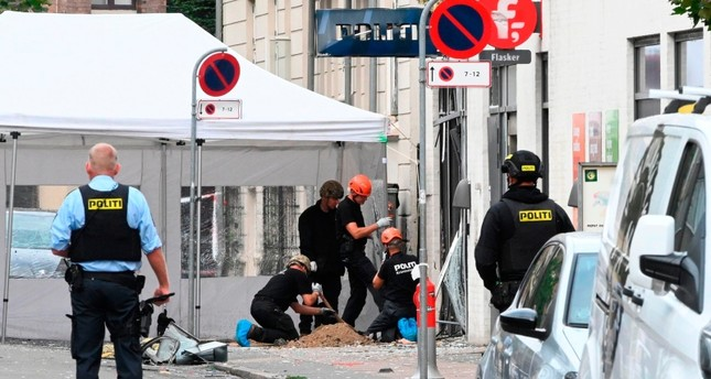 Danish police technicians work inspect the scene on Hermodsgade outside a local police station in Copenhagen on Aug. 10, 2019 AFP Photo