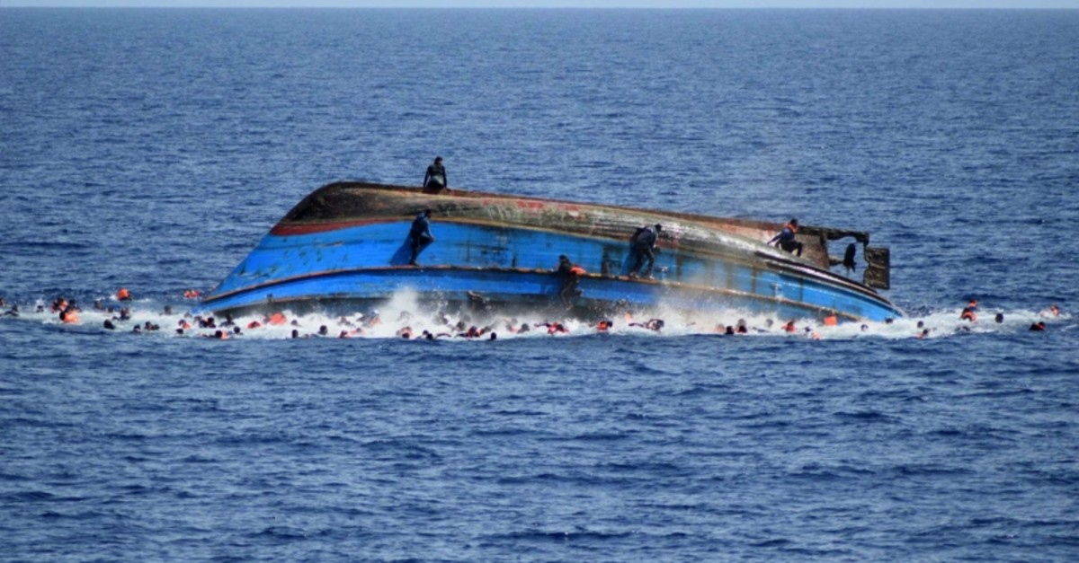People jump out of a boat right after overturning off the Libyan coast, Wednesday, May 25, 2016. (AP Photo)