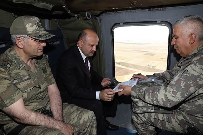 National Defense Minister Fikri Iu015fu0131k (C) visiting Mardin (AA Photo)