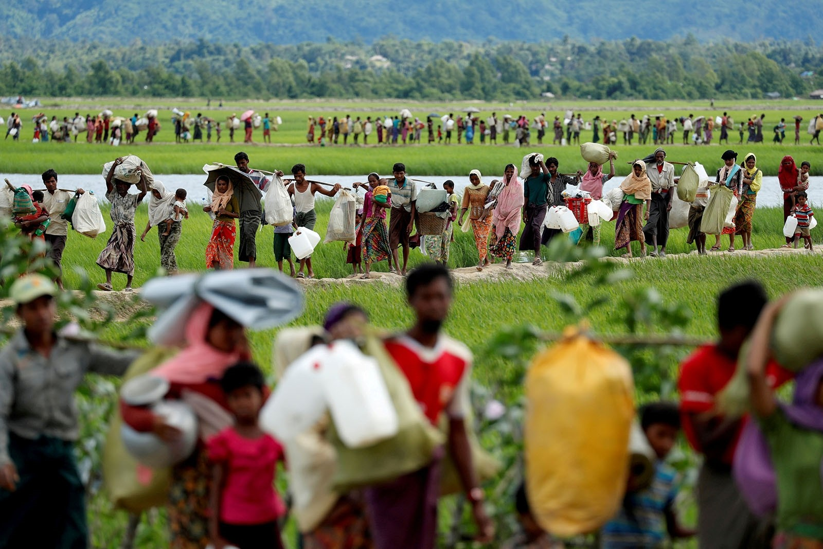 Rohingya refugees, who crossed the border from Myanmar two days before, walk after they received permission from the Bangladeshi army to continue on to the refugee camps, in Palang Khali, near Cox's Bazar, Bangladesh October 19, 2017.