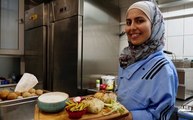 """After fleeing her homeland's civil war, Jazmati reinvented herself in Jordan as a TV chef and became known as the """"queen of cooking"""" to fellow Syrian refugees."""