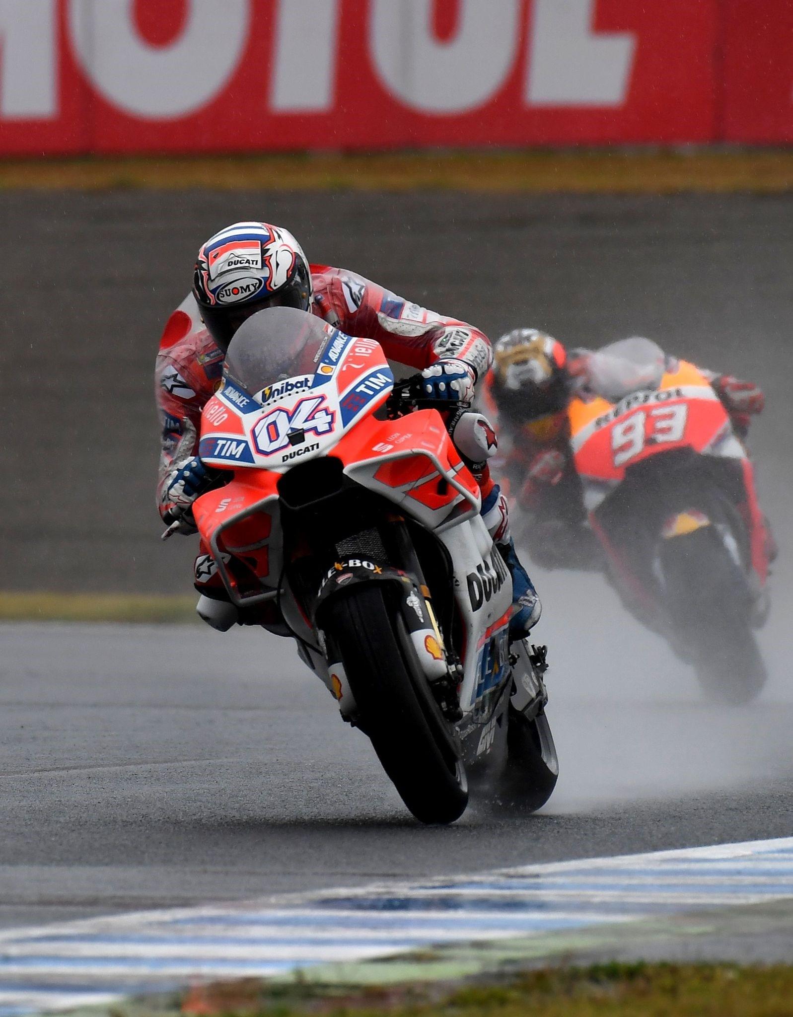 Ducati rider Andrea Dovizioso of Italy (L) leads Honda rider Marc Marquez of Spain (R) during the MotoGP Japanese Grand Prix at Twin Ring Motegi circuit in Motegi.