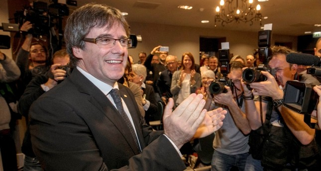 In this Saturday, Nov. 25, 2017 file photo, ousted Catalan president Carles Puigdemont attends a presentation of the candidate list for the Catalan regional elections in Oostkamp, Belgium. AP Photo