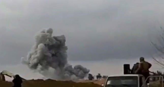 Frame grab from video provided on Feb. 12, 2019, by the Syrian Observatory for Human Rights shows U.S.-backed Syrian Democratic Forces (SDF) fighters looking at smoke rising from a shell that targeted Daesh in Baghouz, Deir El-Zour. (AP Photo)