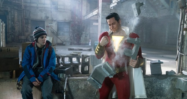 This image released by Warner Bros. shows Zachary Levi, right, and Jack Dylan Grazer in a scene from Shazam! (Steve Wilkie/Warner Bros. Entertainment via AP)