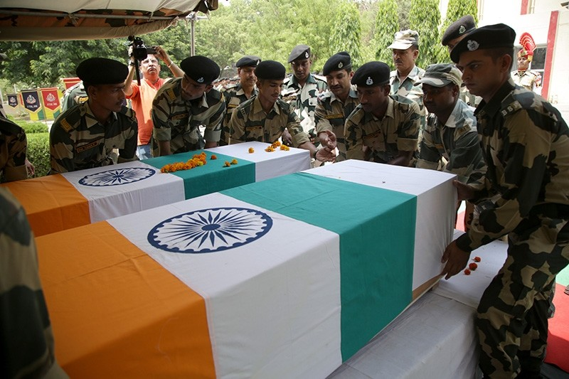 Indian Border Security Force (BSF) soldiers place the coffins of two soldiers killed in an alleged firing from the Pakistan side in Akhnoor sector, during a tribute-paying ceremony at the BSF headquarters in Jammu, India, June 3, 2018. (EPA Photo)