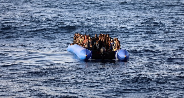 Migrants in a dinghy are rescued by Libyan coast guards off the coast of Garabulli, east of Tripoli, Libya, January 8, 2018. (Reuters Photo)