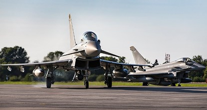 pQatar on Sunday signed an agreement to buy 24 Typhoon fighter jets from Britain, a second major defense deal signed by Doha during its lengthening diplomatic dispute with its...