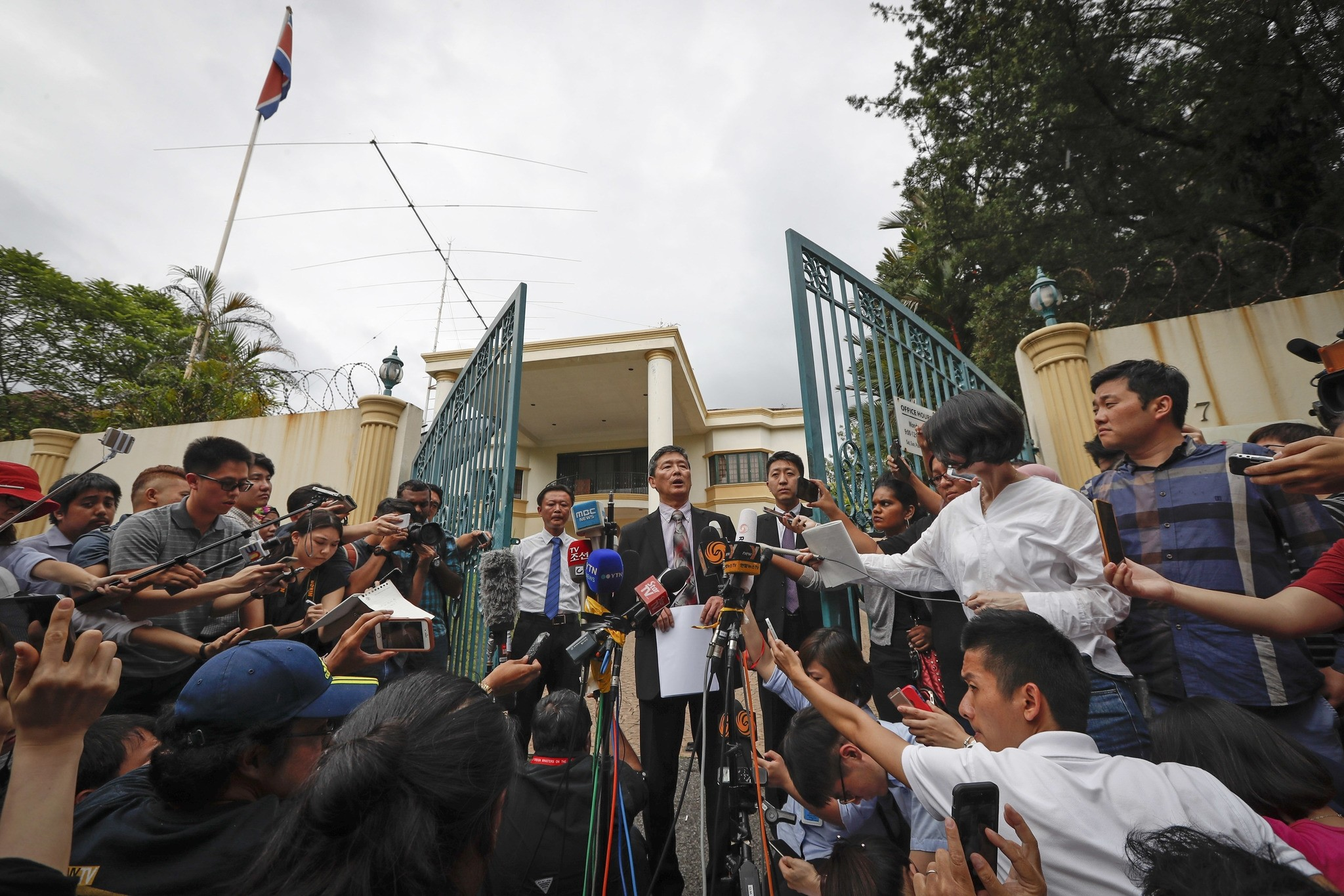 Ri Tong Il, former North Korean deputy ambassador to the United Nations, center, speaks to reporters outside the North Korean embassy in Kuala Lumpur, Malaysia. (AP Photo)