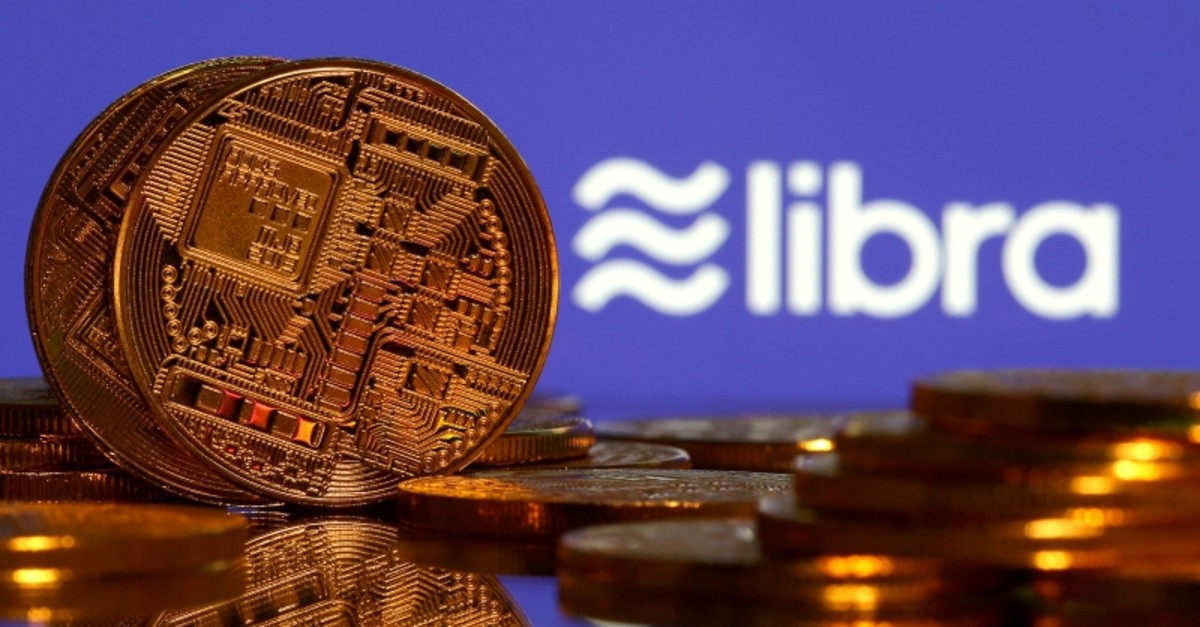 Representations of virtual currency are displayed in front of the Libra logo in this illustration picture, June 21, 2019. (Reuters Photo)