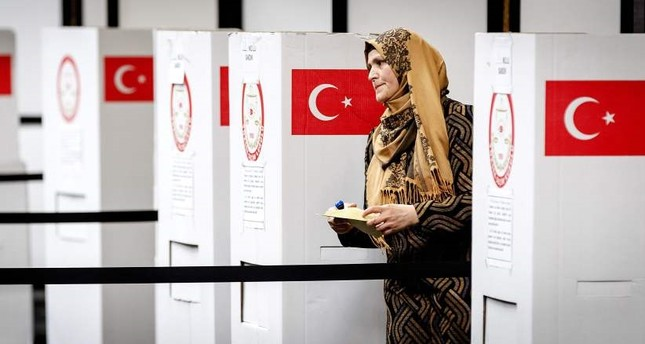 A Turkish voter standing at the polling station for the Turkish referendum in Deventer, Netherlands where the yes vote was 71 percent.