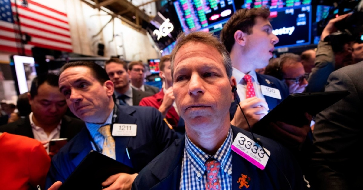 Traders work after the opening bell during the IPO of the ride sharing company Uber at the New York Stock Exchange (NYSE) on May 10, 2019 located on Wall Street in New York City. (AFP Photo)