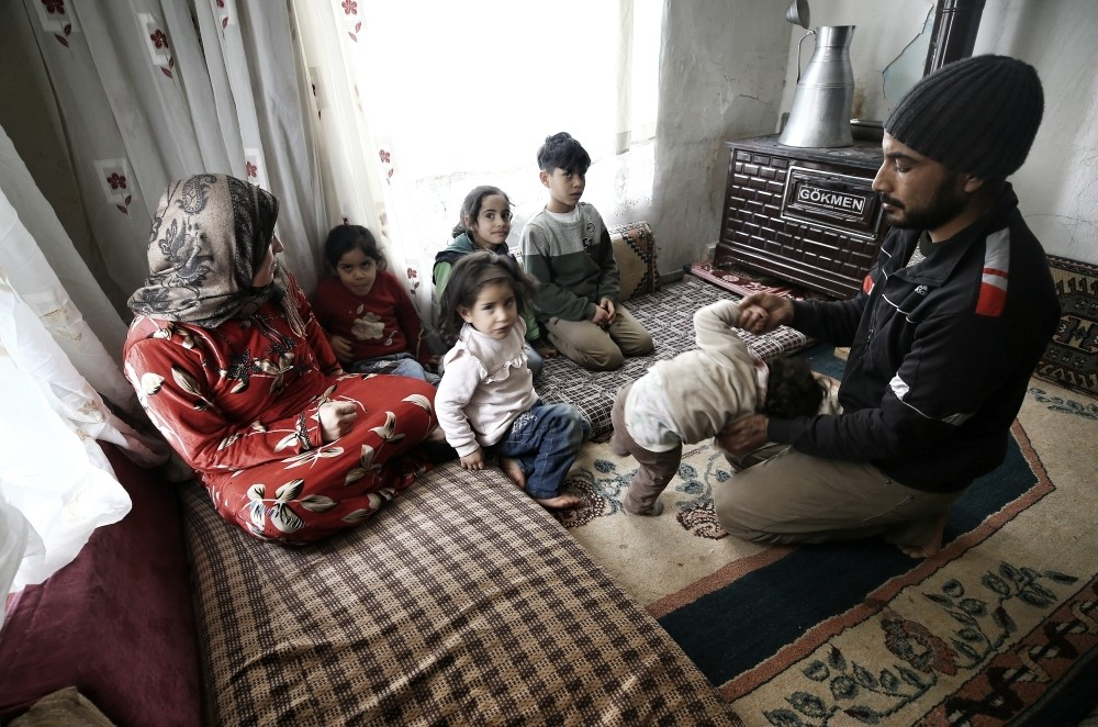 Khaled and Nevroz Ahmer, a Syrian family hailing from eastern Ghouta, play with their children in their home in the central city of Konya on Jan. 18, 2019.